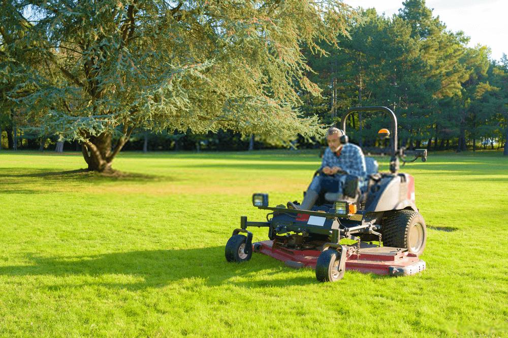 gardener-cutting-grass-of-a-garden-on-a-zero-turn-mower