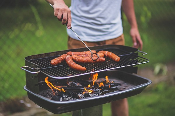 men-using-bbq-grill
