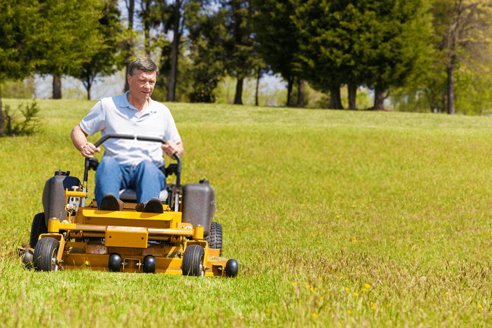 senior-man-on-zero-turn-lawn-mower