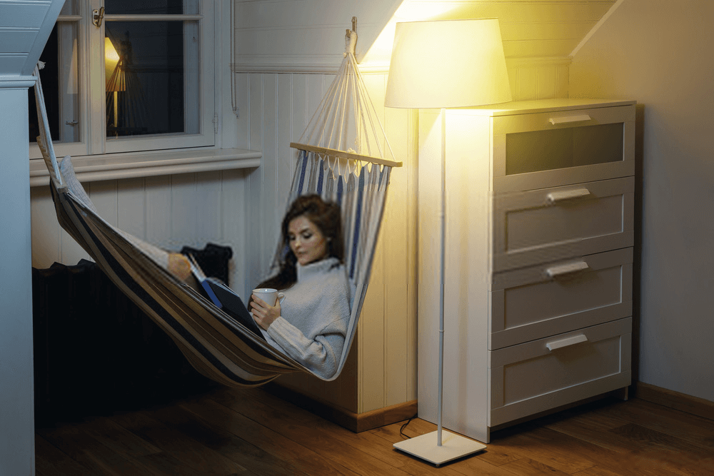 Woman-Lying-in-The-Hammock-and-Reading-Book